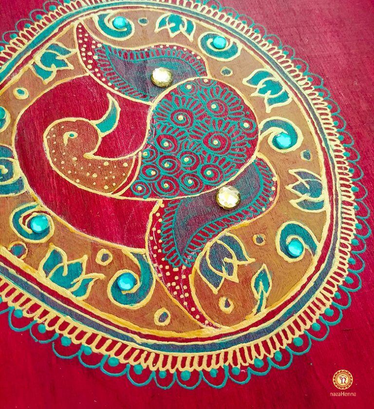 peacock henna painting on wood